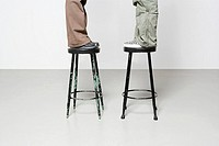 People standing on stools