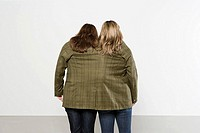 Two women in one jacket