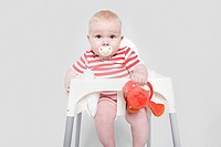 A baby girl in a high chair