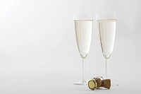 Champagne flutes and a cork