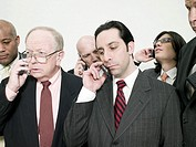 Businesspeople on cellphones (thumbnail)