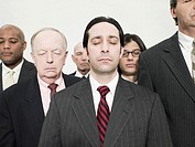 Businessmen with eyes closed (thumbnail)