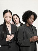 Businesswomen with cellphones
