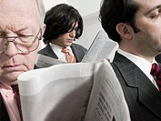 Businessmen reading newspapers