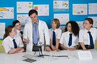 Science teacher and pupils