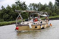 Adventurous Boat Woman, Canal de la Marne au Rhin, near Schwindratzheim, Alsace, France