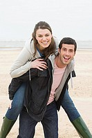 Man giving woman a piggyback