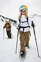 A man and woman skiing