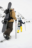 Rear view of two men skiing