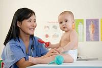A nurse and examining a baby