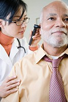A doctor examining a patients ear