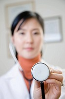 A female doctor holding a stethoscope