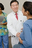 A doctor examining a pregnant patient