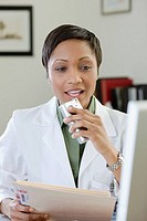 A female doctor talking into a tape recorder