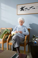 A senior woman waiting in a doctors office