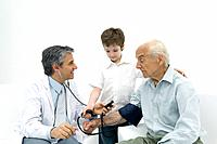 Doctor measuring senior man's blood pressure, boy helping (thumbnail)