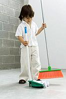 Little boy sweeping the floor