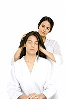 Woman receiving head massage, eyes closed