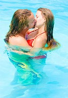 love couple kissing in pool