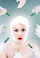Woman with bandaged face surrounded by syringes