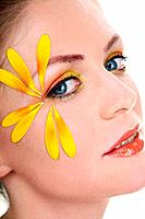 Woman with flower petals decorating her face