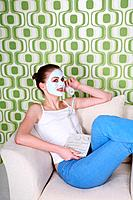 Woman with facial mask talking on the phone (thumbnail)