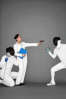 Businesswoman protecting a man by holding a gun at his opponent (thumbnail)