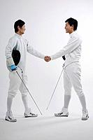 Two men in fencing suits shaking hands (thumbnail)