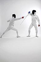 Two men in fencing suits dueling