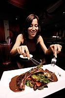Woman tempted to eat lamb chop