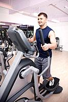 Man exercising on gym equipment