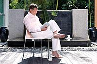 Man reading book at the patio