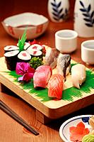 Sushi on a wooden tray (thumbnail)