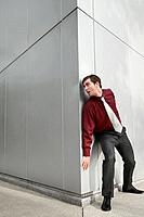Businessman peeking from the corner