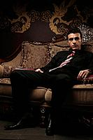 Businessman sitting on antique sofa
