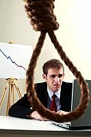 Businessman using laptop, view through a noose