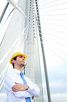 Businessman with safety helmet looking away