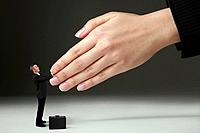 Businessman shaking hands with giant sized hands