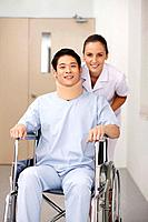 Nurse pushing patient on wheelchair (thumbnail)