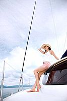 Woman posing on a yacht