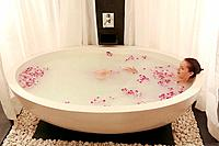 Woman having flower bath