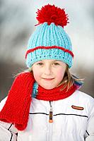 Outdoor winter portrait of 9 year old girl in colourful woolen hat, Winnipeg, Canada