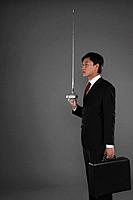 Businessman with a fencing foil