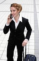 Businesswoman smiling while talking on the phone