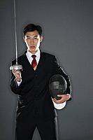 Businessman with a fencing foil and mask