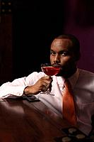 Businessman drinking a glass of cocktail