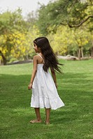 Little girl in park wearing white
