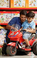 father and son in toy store