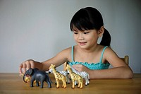 Little girl playing with animals