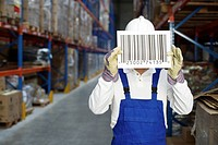 Worker covering his face with a big barcode